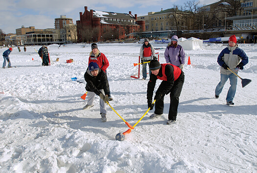 Students play broomball on a cleared section of frozen Lake Mendota. Played like ice hockey (only without skates or, well, rules) broomball has been a popular intramural sport among UW students for decades. This photo was taken during the 2007 Hoofers Winter Carnival. Photo: Jeff Miller