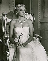Kelly, wearing the final version of the dress, also wore Head's designs in the Hitchcock film Rear Window.