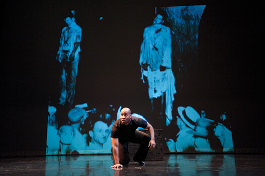 "<p>Fear takes center stage: In his one-man play Ten Perfect, Patrick Sims portrays a fictionalized version of James Cameron, who was nearly lynched in Marion, Indiana, in 1930. Two other men were murdered that night, and the act was captured in an iconic photo (shown in the background) that inspired the lyrics to ""Strange Fruit."" Photo: Jeff Miller</p>"