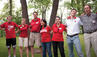 """<p>Alumni from the Chippewa Valley chapter invited future Wisconsin freshmen and their parents to a student send-off in July, where they closed the event by learning how to sing """"Varsity."""" Photo: Bill Hoepner</p>"""