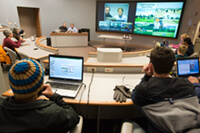 <p>Window into a different world: Using a two-way video feed — and two languages — Michel Wattiaux's dairy science class explores similarities and differences in dairy operations. Photo: Bryce Richter</p>