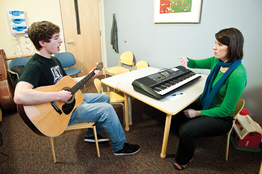 "Wilder Deitz (left) and Sarah Blakeslee (right) practice techniques for avoiding voice fatigue and a sore throat, including ""safe screaming."""
