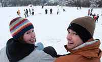 Eileen Bennett x'12 and her brother, Peter Bennett '07, joined the sledding frenzy on Observatory Hill when classes were canceled last December due to a  snowstorm. True to tradition, cafeteria trays were  the conveyance of choice.