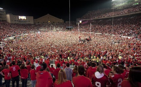 Tens of thousands of fans take to the field in victorious celebration -- and several scale the north goalpost -- after the Wisconsin Badgers football team defeated the No. 1-ranked Ohio State University Buckeyes, 31-18, during a night game at Camp Randall Stadium at the University of Wisconsin-Madison on Oct. 16, 2010. (Photo by Jeff Miller/UW-Madison)