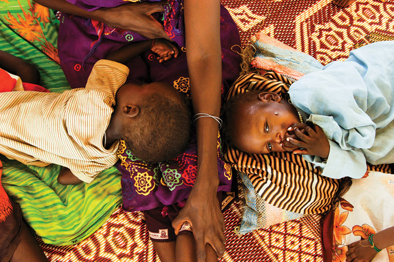 Two malnourished children in a feeding center in Bahai, Chad, in 2004 were among thousands of refugees who poured in from neighboring Sudan to escape the war there.