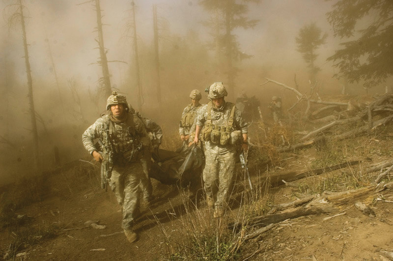 American soldiers in Afghanistan carry the body of a fallen comrade toward a medevac helicopter after an ambush by the Taliban in 2007.