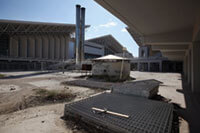 This 2012 photo shows discarded fencing outside the Olympic indoor pool and the OAKA sports hall, leftovers from the 2004 Olympic Games in Athens, Greece. It's not unusual for such facilities to fall into disrepair when cities can't afford to maintain them. Oli Scarff/Getty Images.