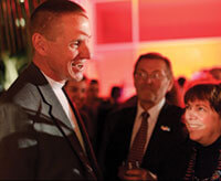 The football Badgers' new coach, Gary Andersen, meets with alumni at a reception the night before the Rose Bowl game. Photo: Jeff Miller.