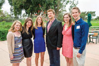 Kelly Kahl '89, executive vice president with CBS Primetime Television (in suit), accepted his Badger of the Year award from the WAA: Los Angeles Chapter at its May Founders' Day. With Kahl are former CBS interns (left to right) Mallory Mason '08, Alexis Krinsky '08, Alexa Sunby '12, Emily Coleman '12, and Dan Brower '11. All are now working in the L.A. entertainment industry. Don Milici photo.