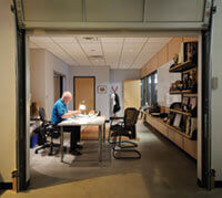 With a nod to his company's modest — but plucky — roots, Fred Foster enters his Middleton office through a garage door.