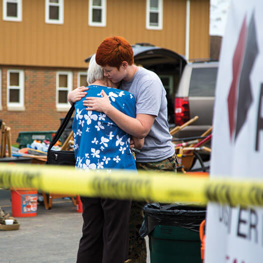 Team Rubicon member offering a hug