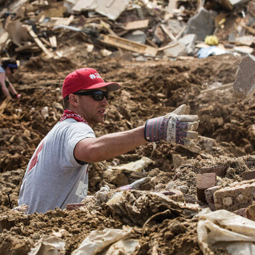 Team Rubicon member working in field
