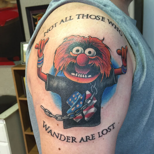 Muppets Animal tattoo that reads, Not all those who wonder are lost
