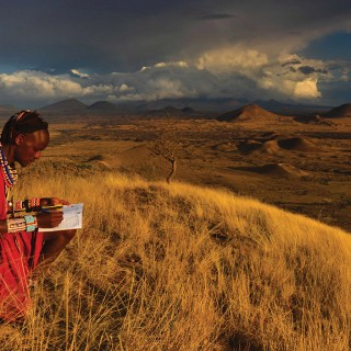 A Masai warrior fills out a form