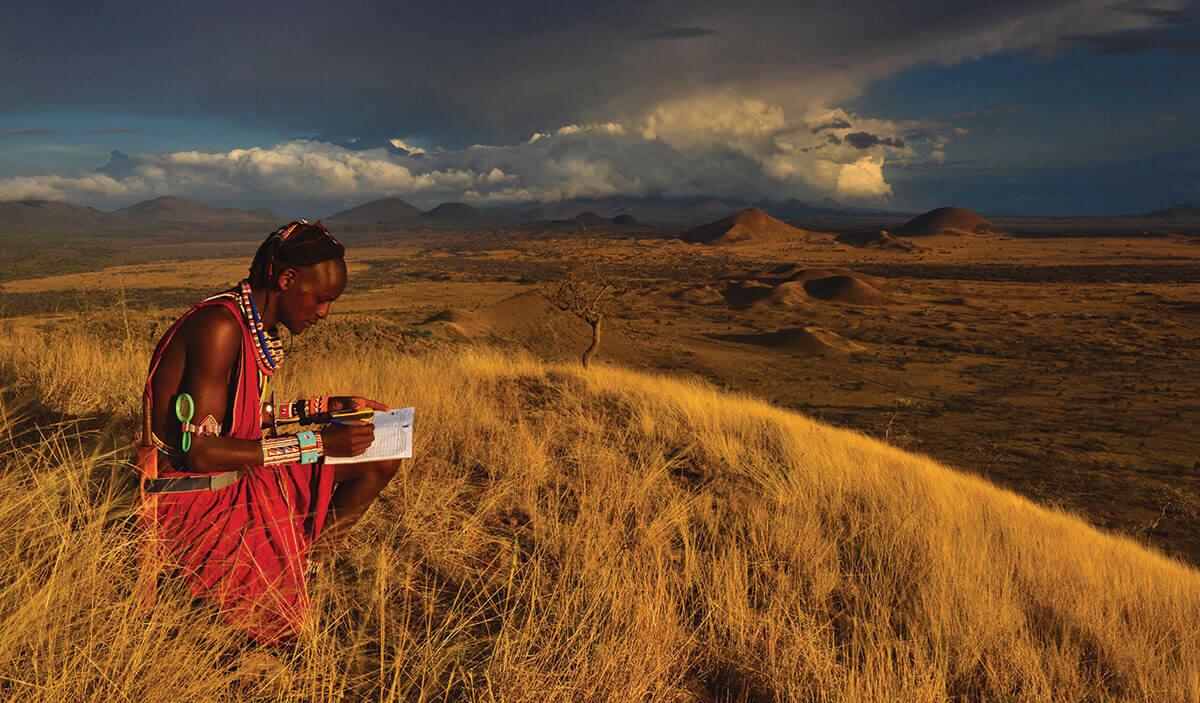 A Masai warrior fills out a form