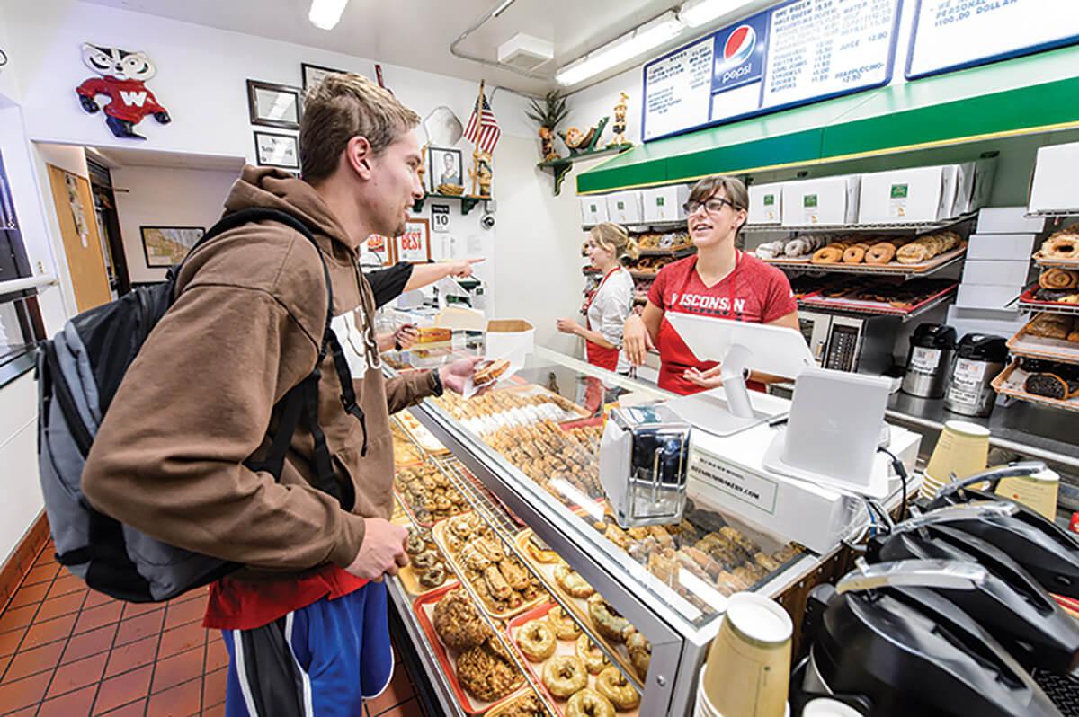 A customer buying donuts
