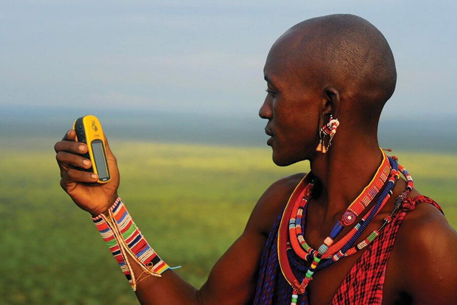 A tribal warrior using GPS technology