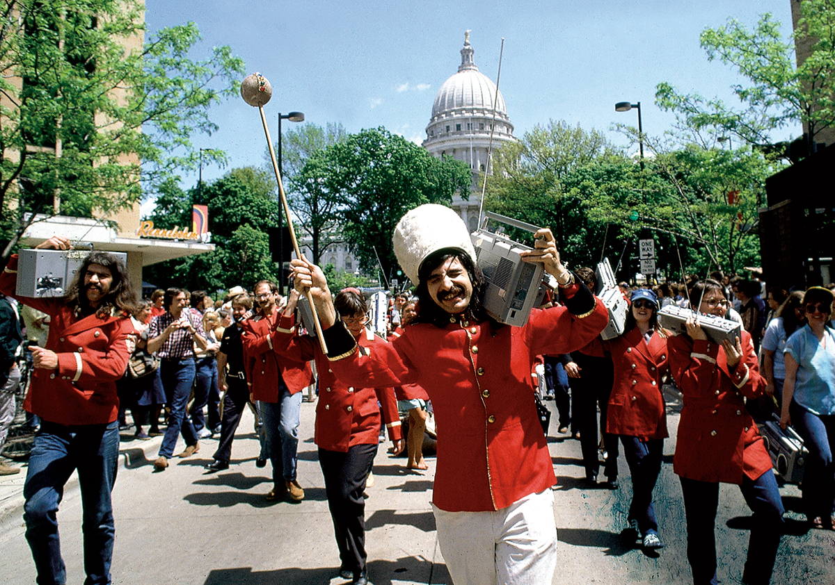 Leon Varjian leads a boom box parade