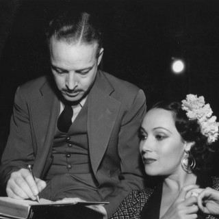The blacklist forced Trumbo (with actress Dolores Del Rio on the set of The Devil's Playground) to use fake names for his work on films including Roman Holiday. Wisconsin Center for Film and Theater Research (WCFTR)