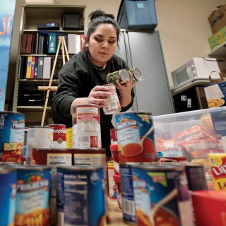 Samantha Arriozola (above) is a volunteer for The Open Seat, the new food pantry inside the UW's Student Activity Center.