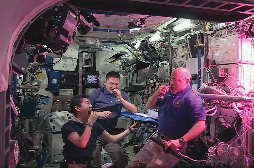 astronauts space grown lettuce