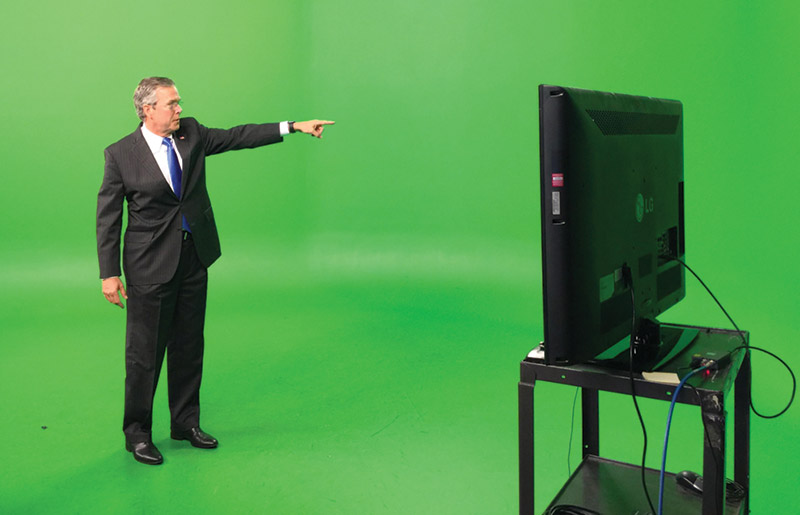 Jeb Bush standing in front of a green screen