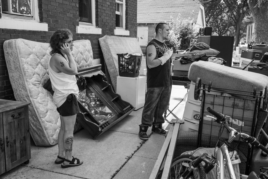 When this mother and son were evicted, she called a relative to come and help them move their belongings.