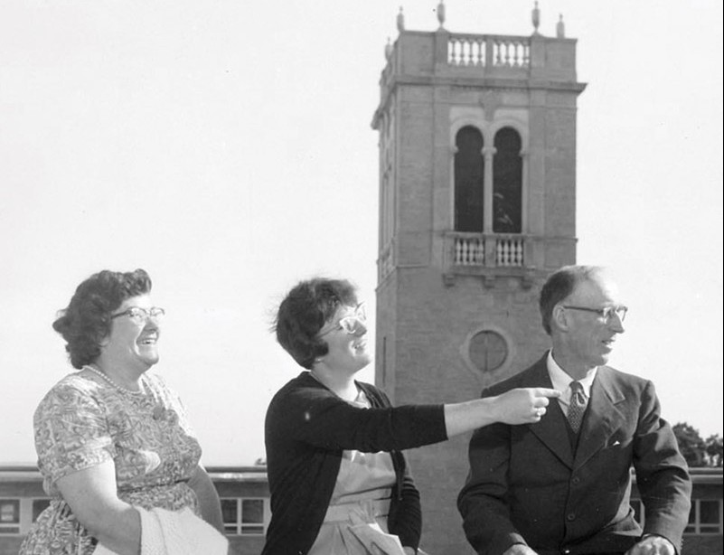 Archival photo of parents in front of Carillon