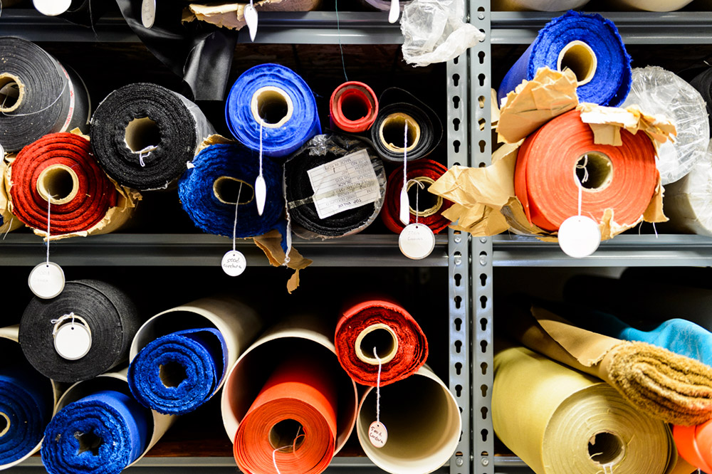 Bolts of fabric used to custom-make jumpsuits, safety gear, and parachutes fill a set of shelves at the Great Basin Smokejumpers' base loft in Boise, Idaho.