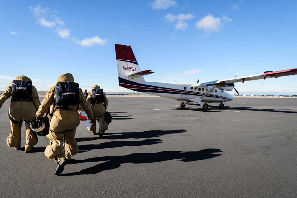 Suited up and ready to go, members of the Great Basin Smokejumpers board a Twin Otter airplane as they prepare for a practice jump.