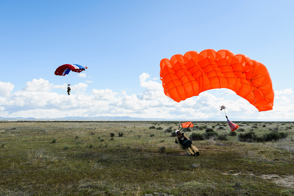 """A pair of smokejumpers —called a """"stick"""" — come in for a landing after a practice jump."""