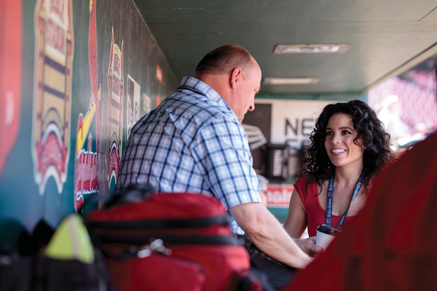 Noboa-Chehade — above in the Cardinals dugout with Director of Communications Brian Bartow — joined the club last year when the league mandated that teams with Spanish-speaking players hire full-time translators.