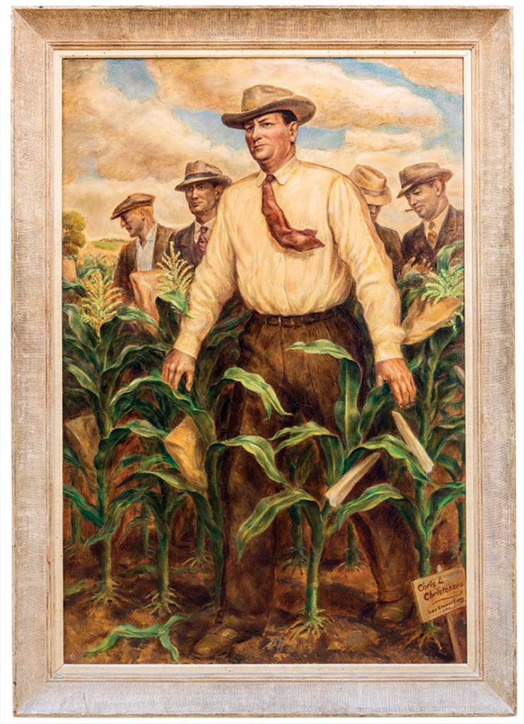 Framed painting of five men, one in foreground and four in background, standing in cornfield.