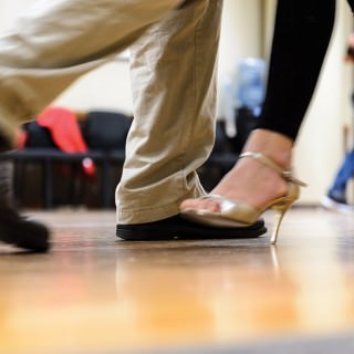 Close-up shot of the feet of a man and woman dancing.