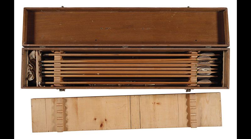 Wooden case filled with handmade arrows.