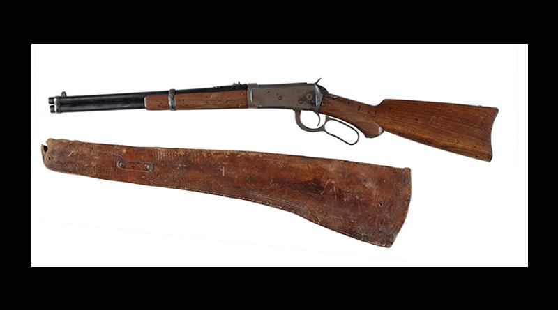 Old shotgun and holster.
