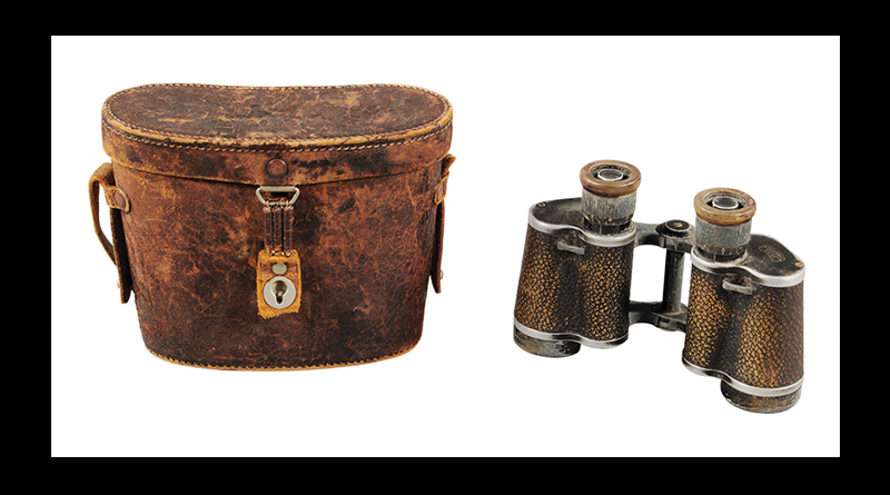 Old pair of binoculars and carrying case.