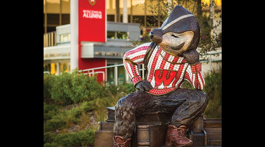 Life-size statue of Bucky Badger in seated position in Alumni Park.