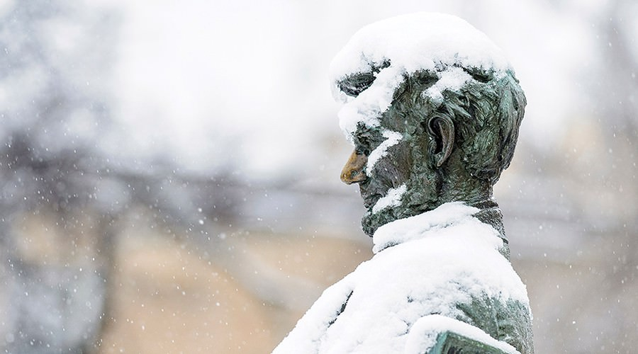 Close-up of snow-covered Abraham Lincoln statue.