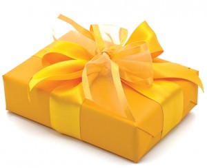 Package wrapped in yellow paper and yellow bow.