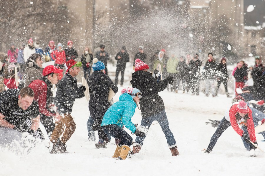 Students participate in a snowball fight on Bascom Hill.