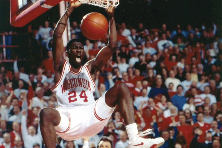 Michael Finley dunks a basketball during a Badger game.
