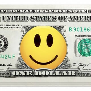 Photo illustration of stack of dollar bills with yellow smiley face over center