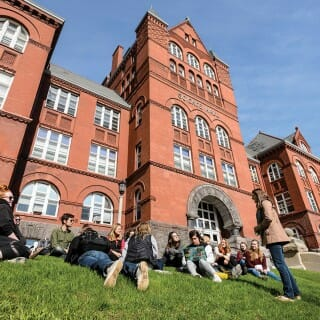 Students lounge on the grass outside of Science Hall at UW-Madison