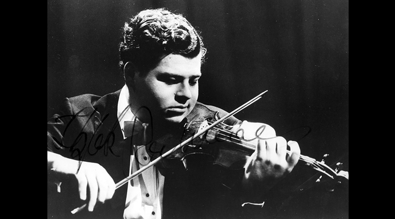 Black and white photo of young Itzhak Perlman playing violin