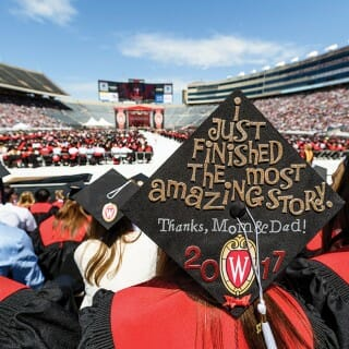 Students attend graduation at Camp Randall stadium