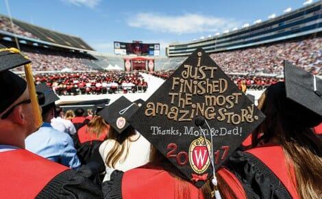 Students attend graduation at Camp Randall stadium