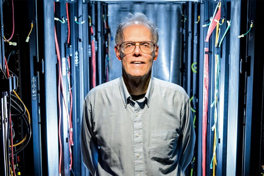 Bill Hibbard stands in server room