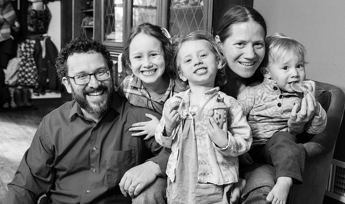 Dan and Iris Levitis pose with their three young children