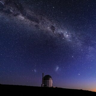 Nighttime sky showing the Milky Way behind the Southern African Large telescope in Sutherland, South Africa